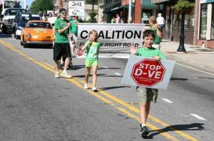 CORR members (in green) take part in Cartersville's Labor Day parade.